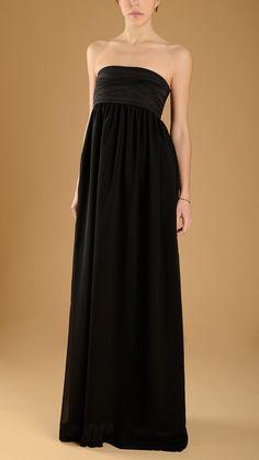 Long, strapless black evening dress.