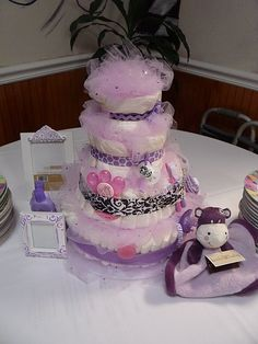 A truly foofoo, fanciful cake here....lots of tulle. A step up from the traditional baby diaper cake.