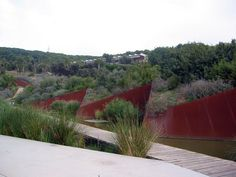 Barcelona's new Botanical Garden was opened in 1999 on an old solid landfill site on the hill of Montjuïc . It was designed by the landscape architect Bet Figueras, the horticulturalist Artur Bossy, the biologist Joan Pedrola and the architects Carlos Ferrater and Josep Lluís Canosa.  Plants are grouped according to five Mediterranean regions. The design is a triangular network adapted with a network of paths.