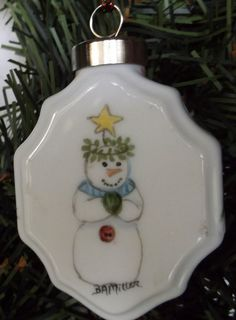 Hand-Painted China Ornament with a Different Snowman on Each side #TwoSidedOrnament #2DifferentSnowmen #ChristmasAccents #OnTheTree #OnAPackage #GreatForDecor #OnAWreath #Personalized #Baby1stChristmas #GirlBaby