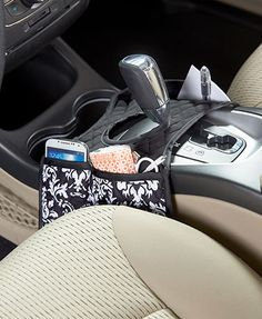 Rely on this Quilted Car Caddy to stay organized while on the go. It fits perfectly around your gearshift on the middle console. A total of 4 pockets, 3 regular