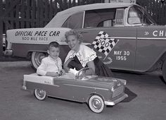 1955 Chevy Pace Car and child pedal car. The woman, I believe, is Dinah Shore but I don't know who the little boy is.