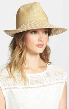 a3909d8d8a9 Two-tone weaving lends modern panache to the brim of a chic Panama hat set  off with a finely woven crown.