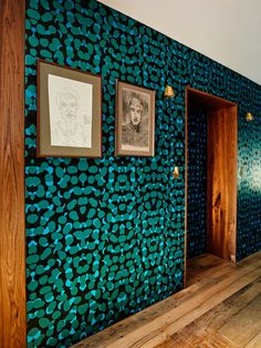 The wallcoverings at this Vinegar Hill, Brooklyn, home include a jewel-toned dot pattern by Kravitz Design in the hallway and a vibrant jungle print in the bedroom, both from Flavor Paper. Photo by Joe Fletcher Originally appeared in Two Apartments Were Combined into This Inviting Brooklyn Home