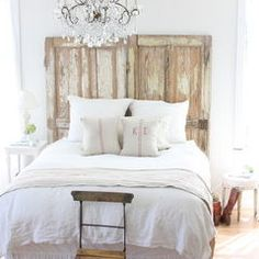 I'm making a headboard out of reclaimed doors, similar to this. Less chabby, and more chic though ;)