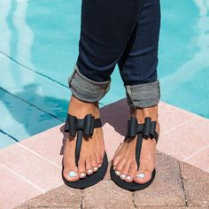 Polish up your poolside look with these chic, bow-topped jelly flip flops! Sizing: This style is available in whole sizes only and tends to run small. If you normally order a 1/2 size it is recommende