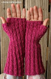 Here is a free pattern for fingerless mitts in worsted weight yarn. They are basic ribbed mitts with some twisted stitches thrown in to break up the boredom of knitting them. Also, twisted stitches add a little something, don't you think?