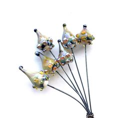 Organic Bulb Drop Lampwork Headpins, Dotted Drop Headpins, Lampwork Drops, Decorative Headpins, Set of 6 by Dry Gulch, Strange Magic #382  This lovely lampwork headpin set includes 3 pairs of breathtaking handmade small-to-medium size drops. We call this pod-inspired shape Organic Bulb Drop and they have gorgeous mottled and swirled colors! And for a dash of extra funkey fabulousness, weve given them fun dots. $12