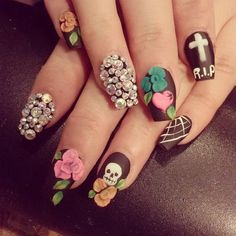 Pin for Later: 102 Halloween Nail Art Ideas That Are Better Than Your Costume Matte and Macabre Source: Instagram user liliana_lopez_