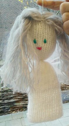 Christmas angel made by another angel on our little knittingmachine. I love this.