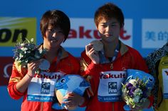 (L-R) Silver medal winner Chen Ruolin of China and Gold medal winner Yajie Si of China celebrate after the Women's 10m Platform Diving final  on day six of the 15th FINA World Championships at Piscina Municipal de Montjuic on July 25, 2013 in Barcelona, Spain.