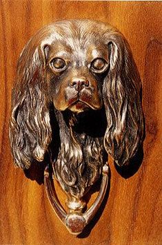 Cavalier King Charles sculpted door knocker cast in fine art bronze, individually hand made upon order. A work of art to last forever.