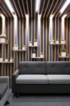 Embracing Wood: Smart Acoustics and Cozy Aesthetics Shape Office in Poznan Regent Insurance Flagship Office – Waiting Area Wall Office Interior Design, Interior Walls, Office Interiors, Office Ceiling Design, Office Designs, Design Commercial, Plafond Design, Waiting Area, Waiting Rooms