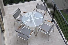 A custom furniture setting for a narrow balcony