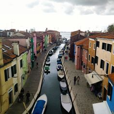 "Colors of #Burano - The view from the roof top restaurant ""Riva Rosa"". Burano island is known for its hand-knitted laces and colored houses. Their colors were to facilitate returning with the catch to..."