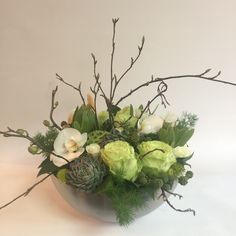 Large Texture Bowl with green roses, succulents, blackberries and Phalaenopsis orchids.  By Fiori Floral Design, Seattle