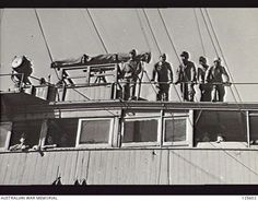 PORT MELBOURNE, VIC. 1946-02-21. JAPANESE NAVAL CREWMEN ON THE BRIDGE OF THE JAPANESE REPATRIATION VESSEL KOEI (KOYEI) MARU TIED UP AT STATION PIER. THE FORMER MINE LAYER WAS SHORTLY TO EMBARK 2800 ...