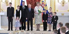 During a ceremony at the Kremlin, President Vladimir Putin awarded the Order of 'Parental Glory' to Valeriy and Tatiana Novik, Jehovah's Witnesses from Karelia.