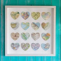 sixteen vintage map hearts - Unframed $520~  I like the idea, take old maps cut out hearts  and select places dear to you & your sweetheart or family, place on a canvas or in a frame.