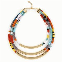 African inspired Triple Strand glass seed bead necklace featuring Gold plated solid brass accents from noirjewelry.com