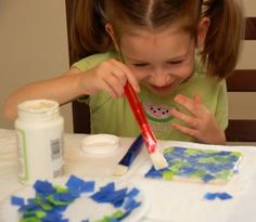 Inexpensive bathroom tiles, colored tissue paper, mod podge, and felt for the bottoms-- colorful coaster for toddler to make as family gifts
