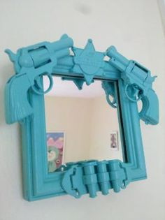 Gun Mirror.. Liliann would love this - maybe in camo... or something army themed with grenades :)