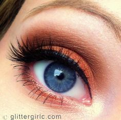 Bronze shadow to make Blue eyes POP !  also try plums and browns, too.