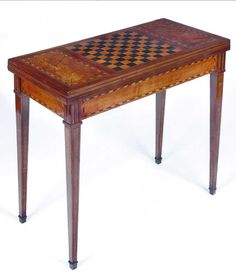 A FRENCH LOUIS XVI MARQUETRY TABLE A JEU, 18TH CENTURY probably provincial, of rectangular form, the closed top revealed marquetry inlaid chess board, featuring ebony, with fine marquetry filet detailing, the top opening to reveal baize surface, on tapering square legs with ebony inlaid and cross banding terminating in ormolu mounts 81cm wide, 14cm deep, 74cm high