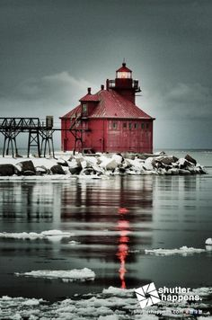 The Sturgeon Bay Canal North Pierhead Light, located on the north pier of the southern entrance to the Sturgeon Bay Ship Canal, lights a path into Lake Michigan on an overcast, snowy March evening.