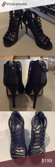 Stiletto sandals Stuart Weitzman black calf 'Marie' open toe and front stiletto gladiator bootie/sandal.  Pristine condition. Worn once. Leather on the heels look like they were just purchased. I have the box and dust cover.  I normally wear a size 7.5, I needed to get these in a 7. Stuart Weitzman Shoes Heels