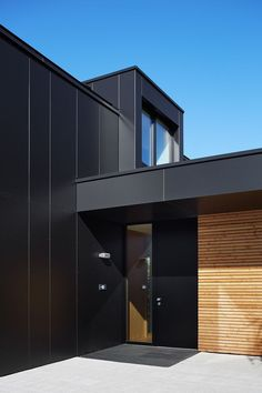 Black steel cladding and timber Exterior Wall Cladding, House Cladding, Facade Architecture, Residential Architecture, Steel Cladding, Black House Exterior, House Extensions, House Front, Exterior Design