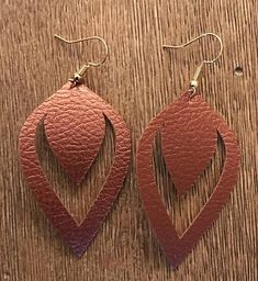 "Beautiful hand crafted faux leather earrings. They are light weight and soft to the touch. Approximately 2"" long and 1.25"" wide. Size may vary slightly."