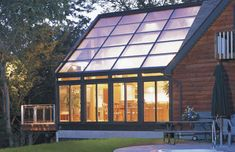 Straight glass roofed sun room or solarium with wood interior