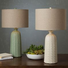 Add an unique attraction to your space with this casual style table lamp. With a ceramic base and linen shade, this perfect piece of table lamp will add a trend worthy twist that will redefine room to