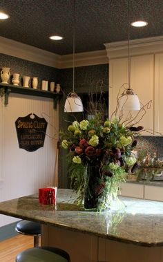 William Morris styled wallpaper craftsman styled home-  fresh arrangement with battery operated  votive candles neatly tucked in