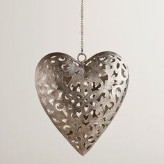 Our lovingly detailed Iron Heart Lantern Tealight Candleholder is cut and etched in India by hand, with a stunning antique silver finish. A wonderful gift for anniversaries or special occasions, the iron lantern's charming heart opens to hold a single tealight. It casts a romantic glow through the intricate etching, instantly softening a room's atmosphere.