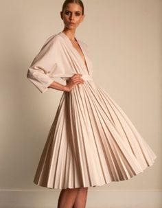 3d944c71baea cream colored Emilia Wickstead pleated dress with dolman, three-quarter length  sleeves and a plunging neckline
