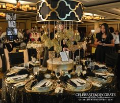 Stunning-black-and-gold-tablescape-at-BASHConf15.  Amazing lamp with hanging gold ornaments.  Beautiful.