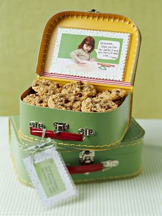 Packed with personality, a heartwarming cardboard lunch box is ideal for a faraway loved one. Send along a photo with a message. Just cut away the background from a snapshot and glue the image on scrapbook paper sized to fit a plastic photo holder. Attach the photo inside the lunch box and fasten a coordinating luggage tag with the recipient's name and address to the handle.