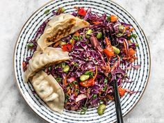 This simple Sesame Slaw makes a great side dish, or a bed for other items like gyoza, fried tofu, or grilled chicken. Step by step photos.