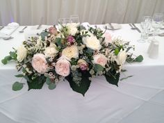 Top table arrangement in pale pink, cream and dusky lilac a perfect combination of colours to match the colour scheme of the wedding