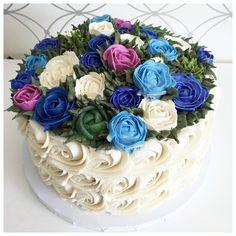 Bespoke buttercream rose garden cake.