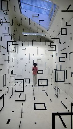 Black White geometric spaces created by linear patterns and planes. Installations by Esther Stocker.