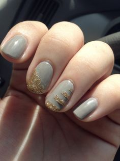 A grayish nude as a base color and some stripping tape to create this simple gold glitter accent.