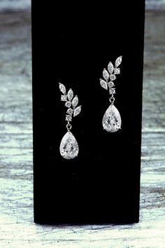 Taylor Bridal Earrings  These glittering dangle bridal earrings feature marquise cut, round cut, and pear cut cubic zirconia stones, set into a silver finish drop design. The Taylor wedding earrings are sure to bring sparkle and elegance to your wedding style!  Pierced earrings.  ● Sizing - 1-1/4 long. ● Packaging - Items are tastefully packaged in jewelry boxes or fabric pouches. ● Shipping - Packages are carefully prepared for shipment via U.S.P.S. ● Payments - I accept gift cards and…