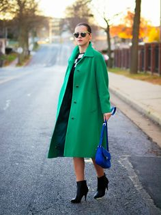 green coat with boots