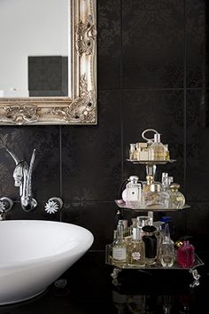 A tier of fragrances and amazing custom faucet