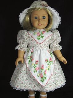 Doll Clothes By Shirley  That is absolutely a vintage handkerchief used as the yolk and the apron.  Fabulous short cut idea.