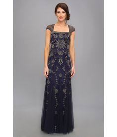 The starry sky looks dull compared to you in this exquisite Adrianna Papell™ beaded gown.. Allurin...