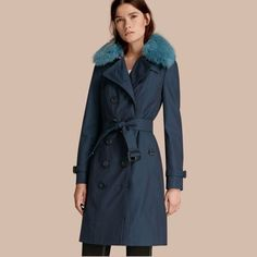 A classic cotton trench coat in English-woven cotton gabardine, designed for smart dressing. A detachable fox fur collar adds textural interest and warmth, while a button-out wool cashmere blend warmer suits changeable weather. The classic shape is cut in our Sandringham slim fit, crafted to contour the body for a streamlined silhouette.
